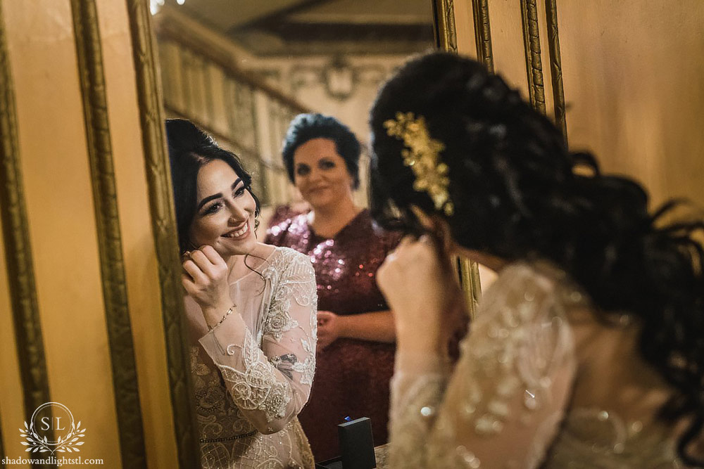 Fox Theater St. Louis wedding photo with bride getting dressed