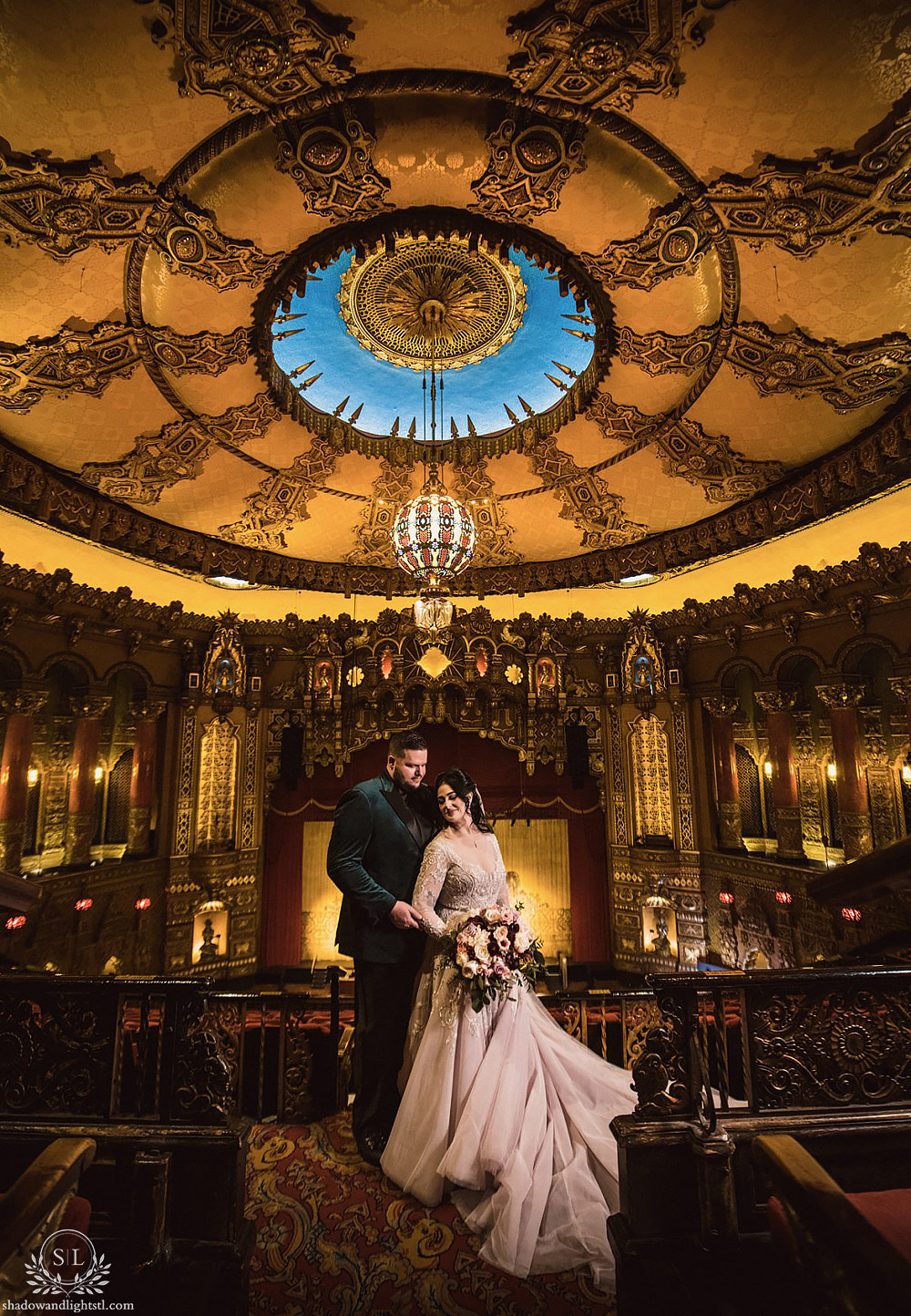 Incredible Fox Theater St. Louis wedding photo with bride and groom on Fox balcony