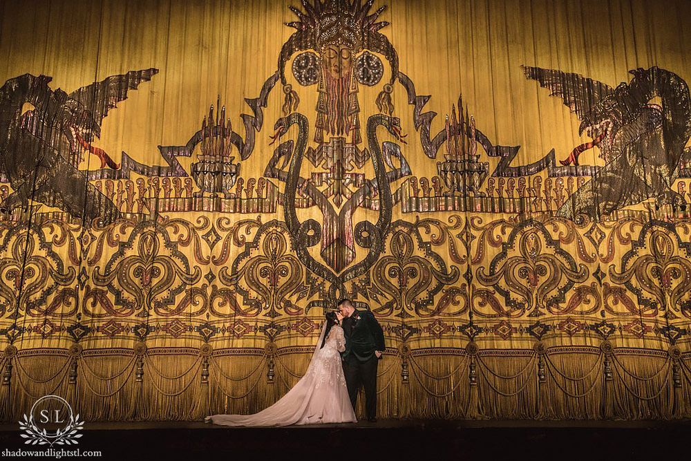 Incredible Fox Theater St. Louis wedding photo with bride and groom on the stage