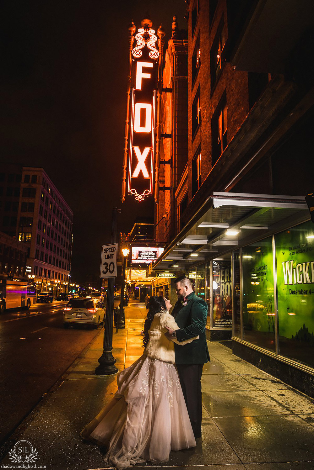Incredible Fox Theater St. Louis wedding photo with bride and groom outside of the Fox