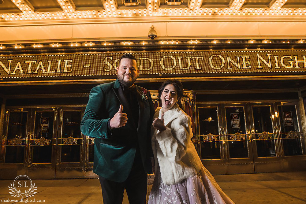 Incredible Fox Theater St. Louis wedding photo with bride and groom being funny