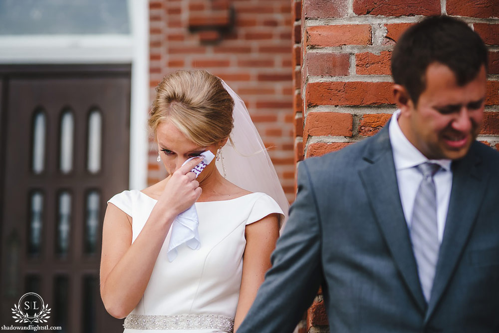 bride and groom first look crying