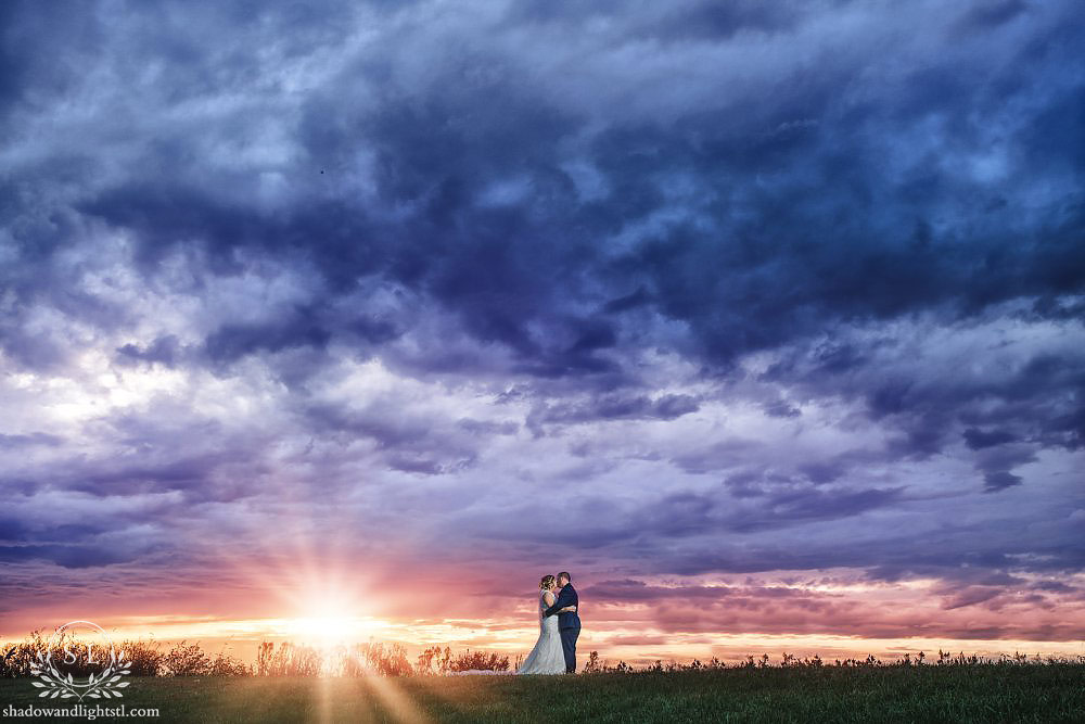 sunset at bretz wildlife lodge and winery wedding in carlyle, il