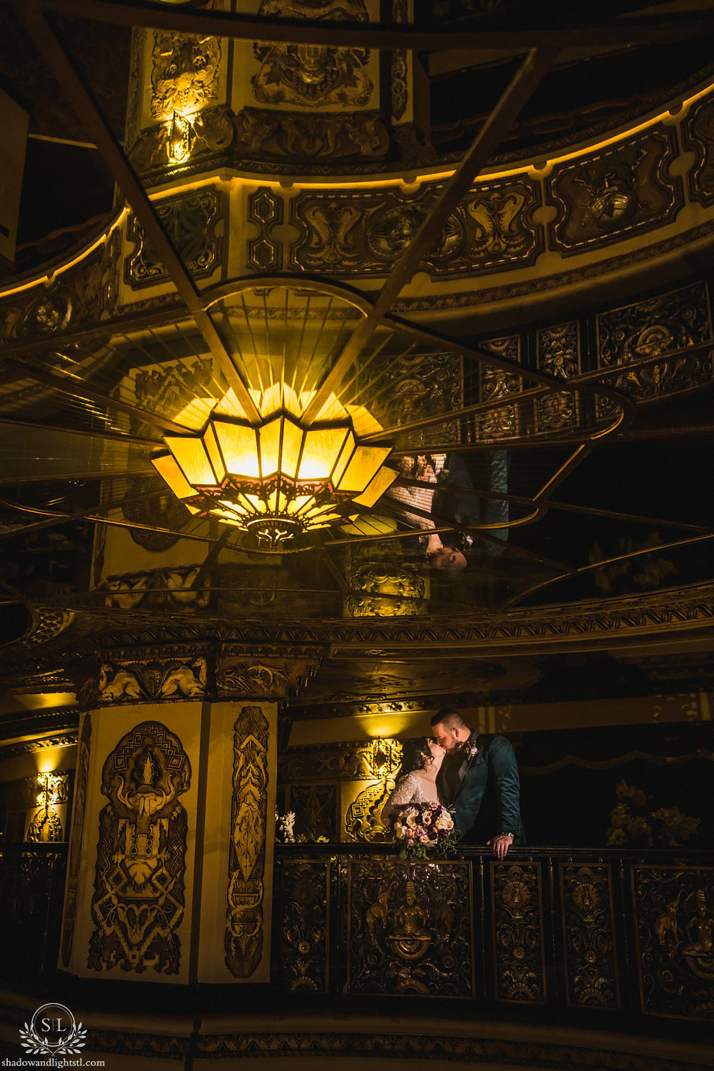Incredible Fox Theater St. Louis wedding photo with bride and groom on balcony