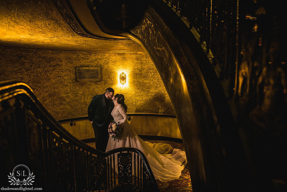 Incredible Fox Theater St. Louis wedding photo with bride and groom on stairs