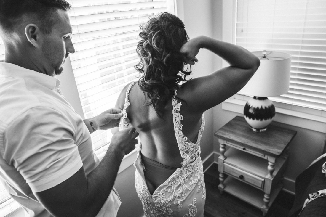 bride and groom dressing