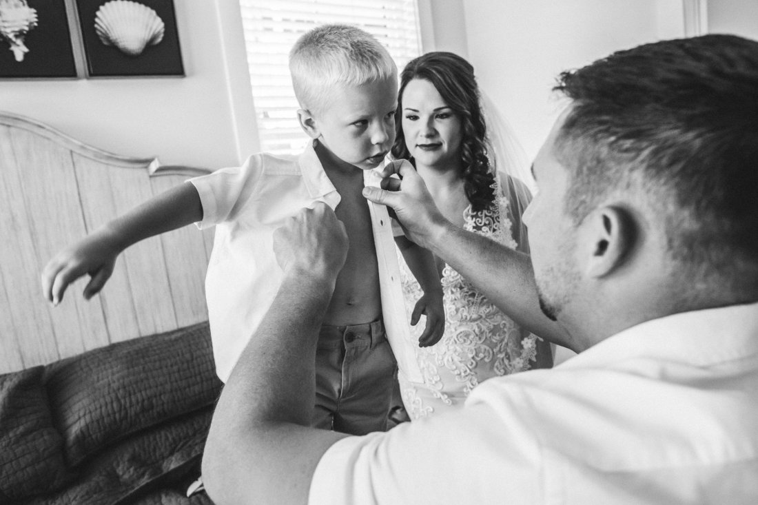 bride and groom dressing son